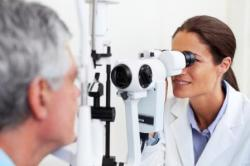 Optometrist testing patients vision