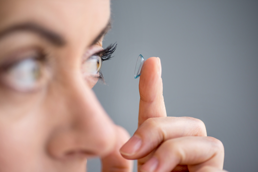 Woman with a contact lens